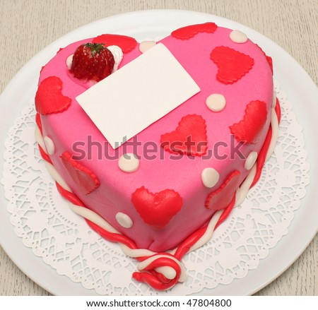 Beautiful decorated cake, heart shape, with strawberry