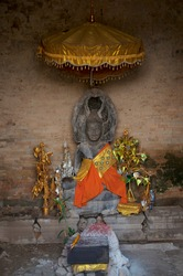 Beautiful decorated stone Buddha statue in the Angkor Wat building temple in Siem Reap, Cambodia