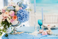 Beautiful decorated table set for wedding party. Wedding decorations with flowers