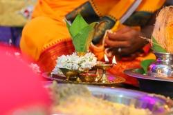 Beautiful decorated thali with kumkum,diya,flower,sweet
