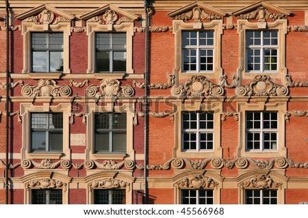 Beautiful decorative architecture in Lille, France. Town square windows.