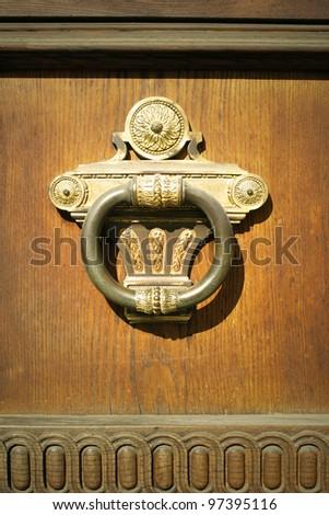 Beautiful decorative massive handle in ancient roman empire's style
