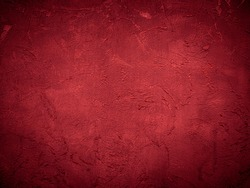 Beautiful decorative Venetian plaster in red. Plastered wall texture for backgrounds