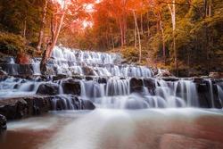 Beautiful deep forest waterfall are arranged like steps at Sam lan waterfall National Park Saraburi Thailand in autumn