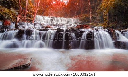 Beautiful deep forest waterfall are arranged like steps at Sam lan waterfall National Park Saraburi Thailand in autumn stock photo