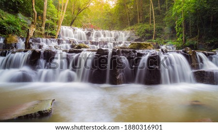 Beautiful deep forest waterfall are arranged like steps at Sam lan waterfall National Park Saraburi Thailand stock photo