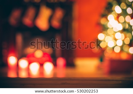 Beautiful  Defocused background new year room with decorated Christmas tree, gifts and fireplace with the glowing lights at night. The idea for postcards. Soft focus. Shallow DOF.