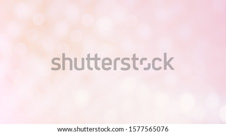 Beautiful Delicate blurred light pink Background with bokeh lights. Wide Angle Soft Pastel Texture, defocused. Background can be used for design greetings cards, invitations or promotional flyers. #1577565076