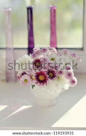 beautiful delicate bouquet of pink chrysanthemums in a blue bucket