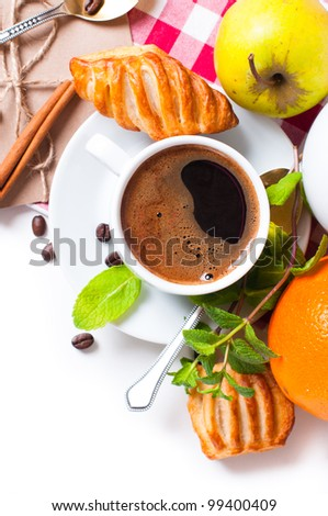 Beautiful delicious breakfast, coffee and pastries on the tablecloth - stock photo
