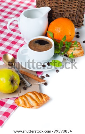 Beautiful delicious breakfast, coffee and pastries on the tablecloth
