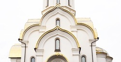 Beautiful design elements in a church, golden vaults and white walls, background