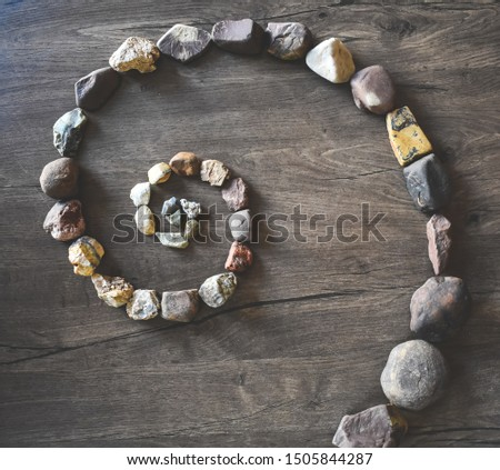 beautiful design of golden ratio of Fibonacci sequence with colorful stones start from small to big