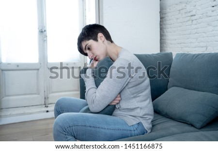 Beautiful desperate and depressed young woman on sofa feeling sad, hopeless and in pain suffering from Depression in People, Mental health,broken heart, Grief and Psychology concept.