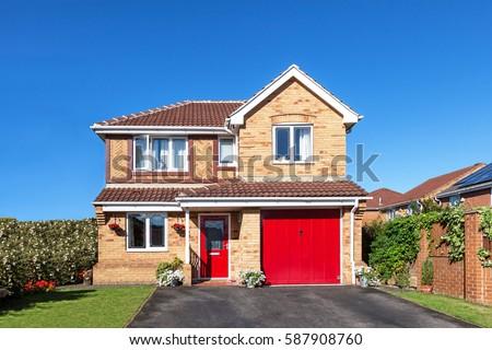 Beautiful detached house with red door ストックフォト ©
