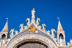 Beautiful details of Basilica di San Marco in Venice. Architectural design in Venice, horses, golden statues and towers of the Basilica di San Marco.