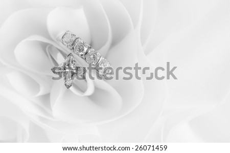 Beautiful Diamond Wedding Rings on white background with space for copy.
