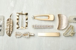Beautiful different hair clips on white table, flat lay