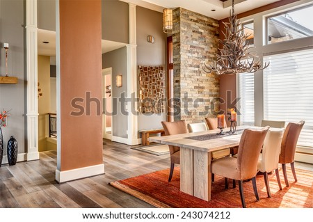 Beautiful Dining Room with Entryway, Table, Elegant Light Fixture in New Luxury Home