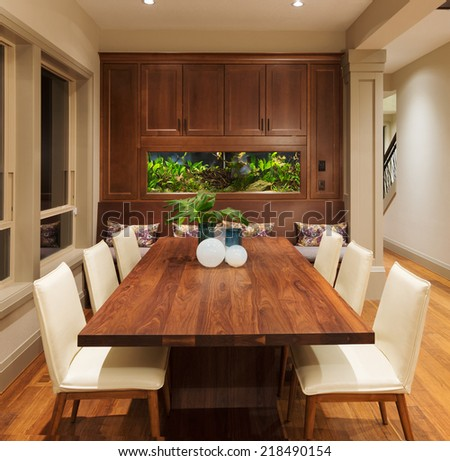 Beautiful Dining Room with Fish Tank in New Luxury Home