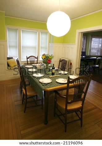 beautiful dining room with table set for dinner