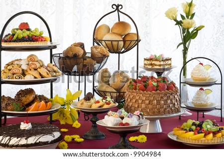 stock photo : Beautiful display of cakes, muffins, pastry, breads, cookies, pies and fruit tortes.