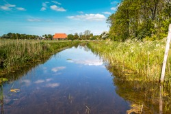 Beautiful ditch in the Netherlands, province Friesland, nearby the village Harich region Gaasterland