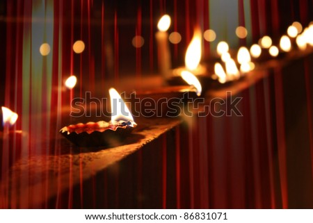 Beautiful diwali lamps traditionally lit on the occasion of Diwali festival in India with beautiful red light streaks