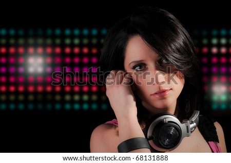 Beautiful DJ Girl with Club Lights in the background