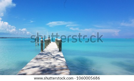 Beautiful Dock looking out to perfect turquoise waters on a secluded beach in Exuma Bahamas