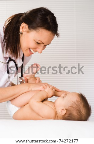 beautiful doctor and baby on a white background
