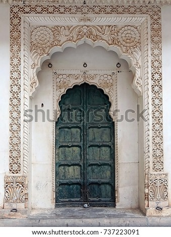 Beautiful door portal in the old city of Jodhpur with carvings in oriental style