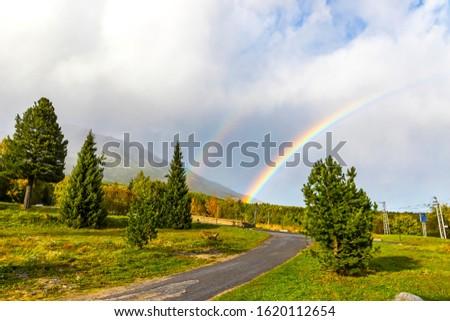 Beautiful double rainbow over woods at Vysoke Tatry town in High Tatras mountains, Slovakia Stockfoto ©