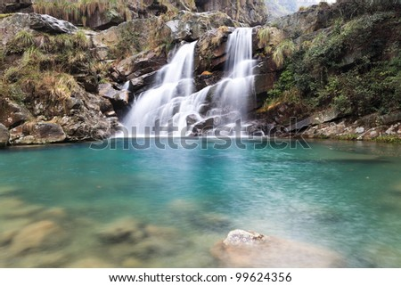 beautiful double waterfall in early spring - stock photo
