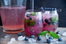 Beautiful, dramatic blueberry mojito image in dark moody style