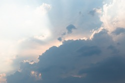 Beautiful dramatic gray and white clouds on blue sky, variety of shapes, silhouettes and shades at sunset time
