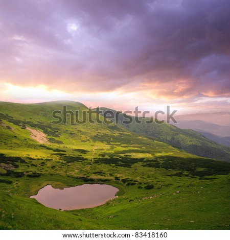 Beautiful dramatic sky and sundown Carpathian mountains