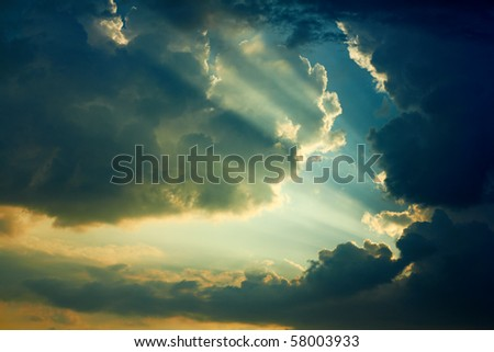 Beautiful dramatic sky with sun rays.