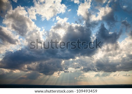 Beautiful dramatic sky with sun rays. Blue Heavens Idyllic Wallpaper Broad Daylight.