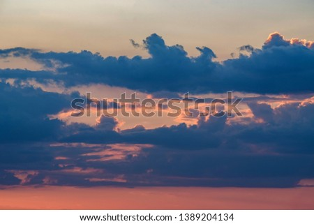 Beautiful dramatic sunrise skyscape background with clouds #1389204134