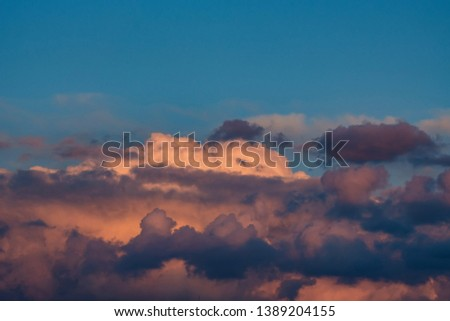 Beautiful dramatic sunrise skyscape background with clouds #1389204155