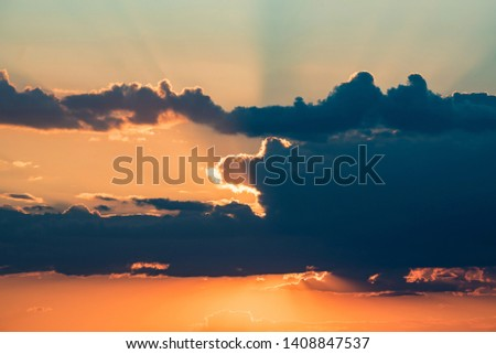 Beautiful dramatic sunrise skyscape background with clouds #1408847537