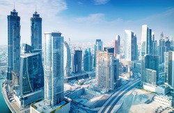 Beautiful Dubai city, bird eye view on majestic cityscape with modern new buildings, daytime panoramic scene, United Arab Emirates
