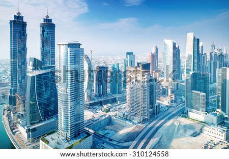 Beautiful Dubai city, bird eye view on majestic cityscape with modern new buildings, daytime panoramic scene, United Arab Emirates #310124558