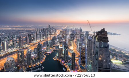Beautiful Dubai Marina area and sea shore during sunset at evening, Dubai, UAE #722956513