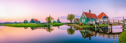 Beautiful Dutch scenery panorama of Zaanse Schans windmill village in Netherlands