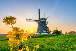 Beautiful Dutch traditional windmill at sunset