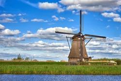 Beautiful dutch windmill under the cloudy sky in Kinderdijk