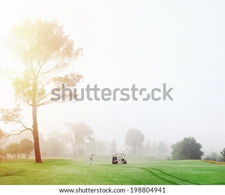 Beautiful early morning golf game at the course in the sunrise and panoramic view