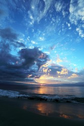 Beautiful early morning seascape with picturesque clouds near Mossel Bay in South Africa